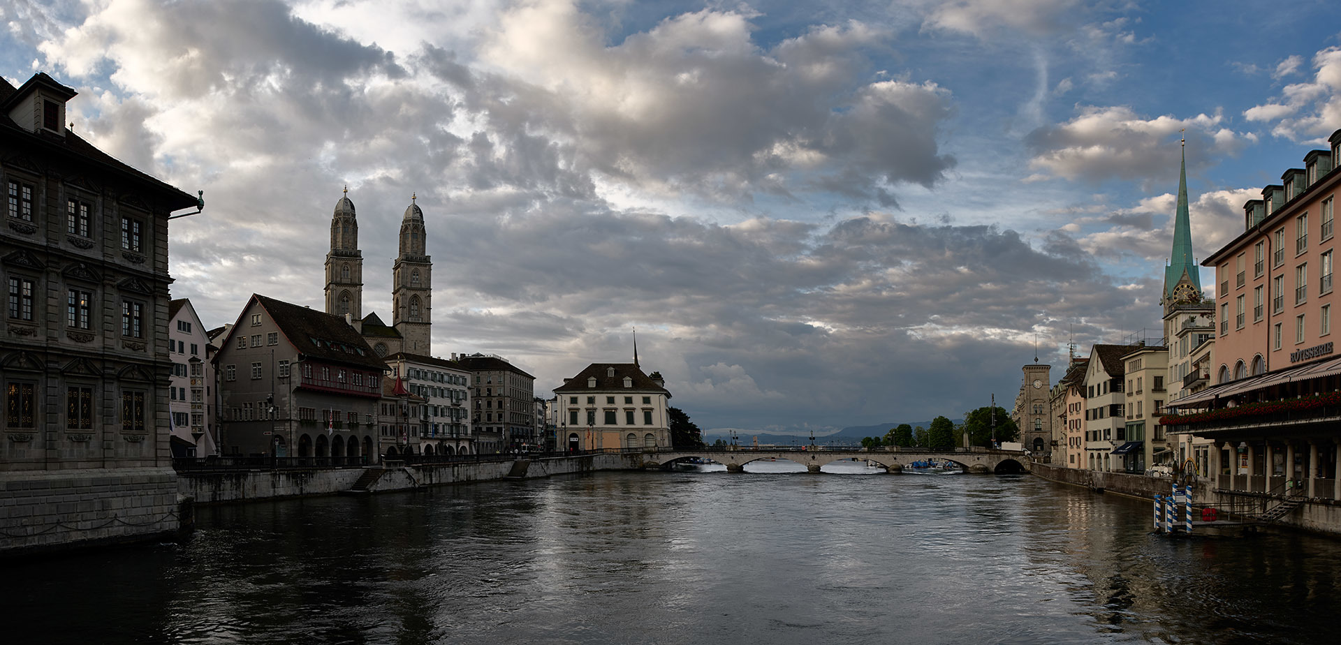 Cloudy sky over old city and river