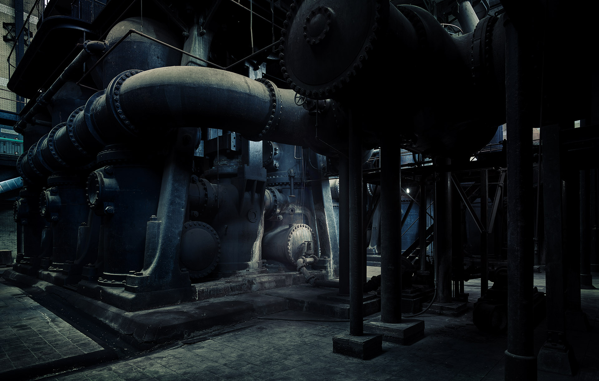 Pipes and motors inside factory