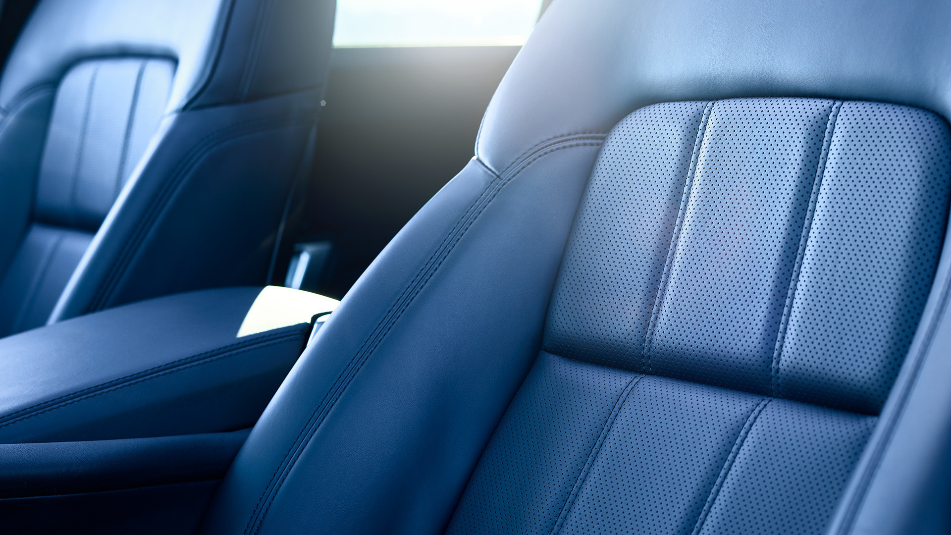 Comfortable front seats in car in sun light